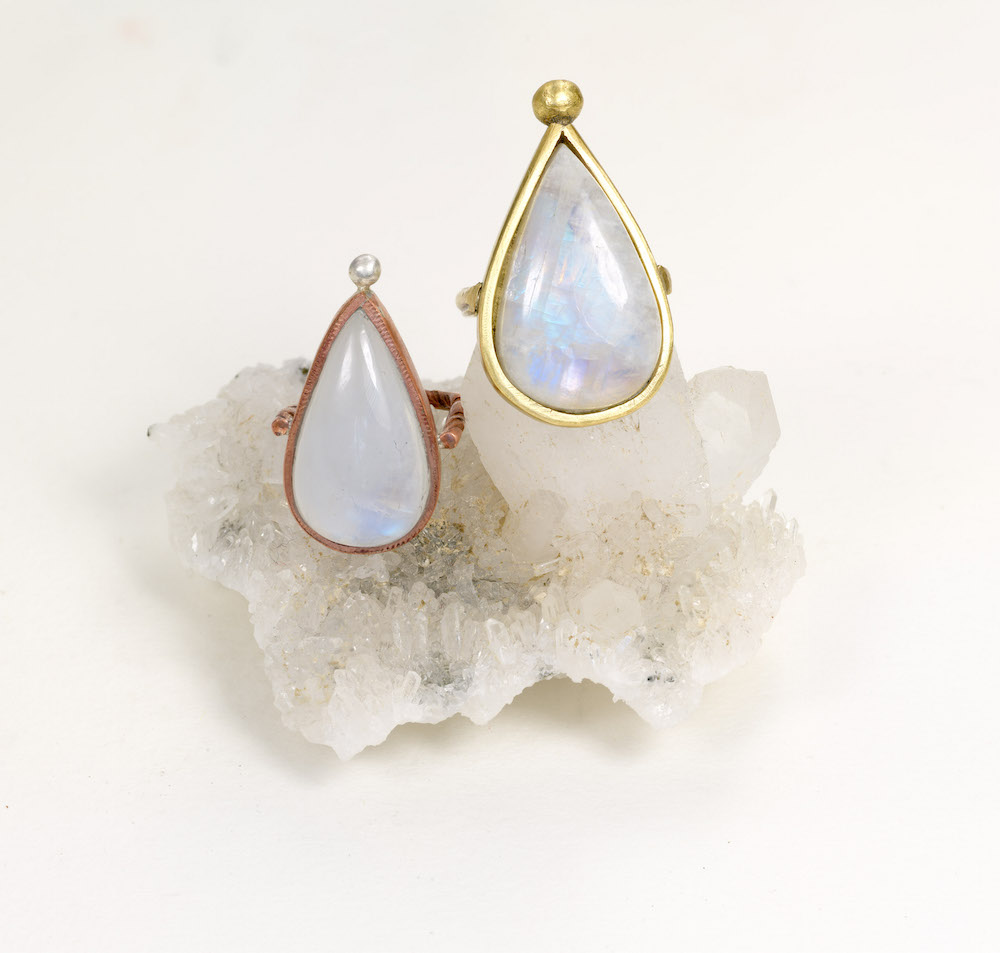 Femininity - Moonstone rings, one set in copper with silver, the other in brass